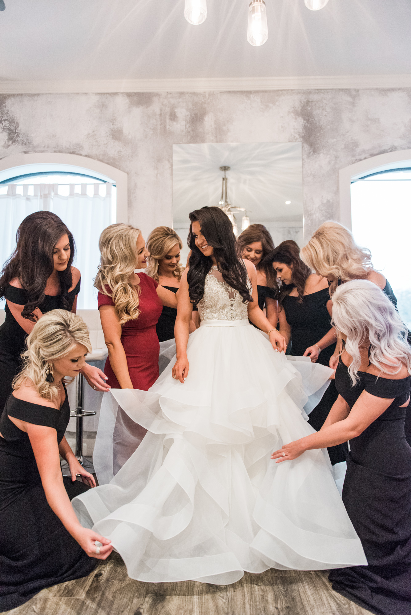 Brownstone Wedding with eight bridesmaids helping bride fluff her Maggie Sottero gown by Wedding Photographer in Houston Thomas Ross Photography